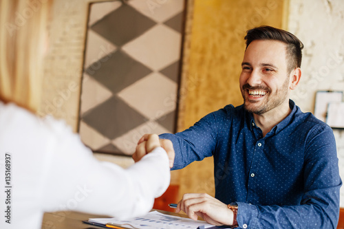Businessman and businesswoman handshake