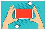 Fototapety Comic smartphone phone with halftone shadows. Hand holding smartphone. Pop art retro style. Flat design. Vector illustration eps 10