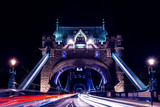 Tower Bridge in London at night with car traffic light trails