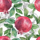 Seamless pattern with pomegranate and leaves on a white background. Watercolor handmade drawing.