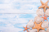 Starfishes and seashells on rustic wooden background - 135199192