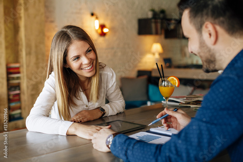 Young business woman and man at job interview in a cafe