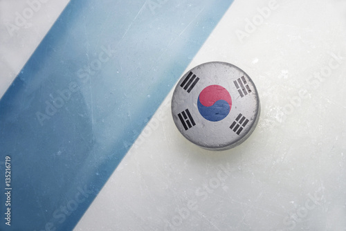 old hockey puck with the national flag of south korea.