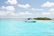 Small riding boat near island on sea