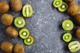 Kiwi fruits on stone background