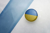 old hockey puck with the national flag of ukraine.