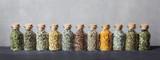 Different kinds of herbs for tea inside glass bottles.