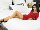 Beautiful woman wearing fashionable figure hugging red dress