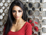 Beautiful woman with exotic features and long dark hair