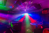Night club interior with colorful spot lights