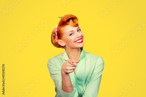 Poster portrait of a beautiful woman pinup retro style pointing at you smiling laughing