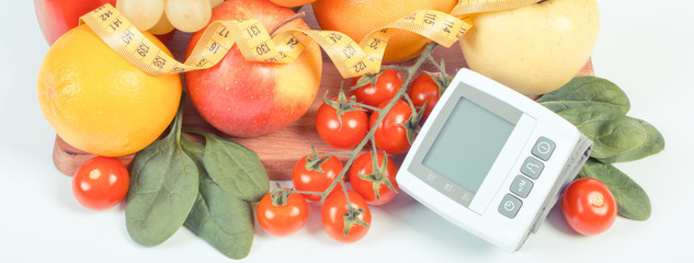Vintage photo, Blood pressure monitor, fruits with vegetables and centimeter, healthy lifestyle