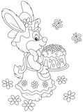 Easter rabbit holding a freshly backed and colorfully decorated holiday cake