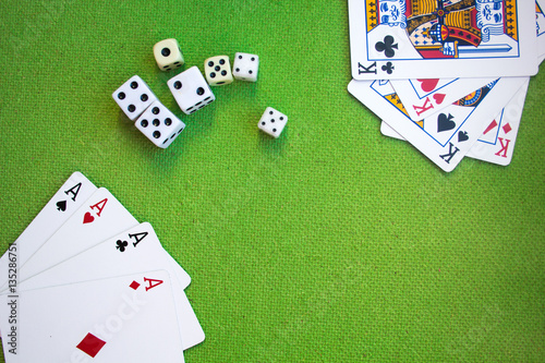 cards and dice on green background плакат