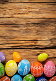 Fototapety Easter eggs placed on wooden board