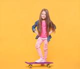 little girl isolated on yellow background
