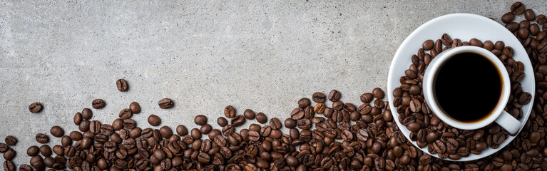 Cup of coffee with coffee beans on gray stone background. Top view © Leszek Czerwonka