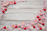 Wooden background with lace, hearts and flowers
