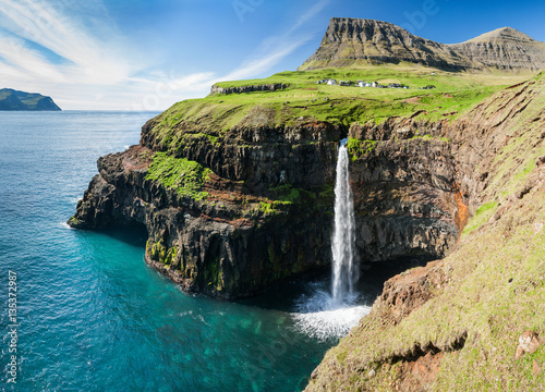 waterfall on faroe islands and the village Gasadalur in background Poster