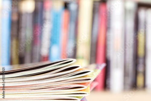 Close up edge of colorful magazine stacking Poster