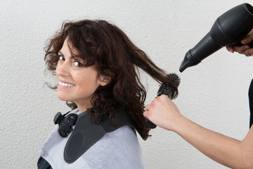 Portrait of a happy and smiling woman at the hair salon