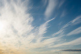 Surreal cirrus clouds on blue sky