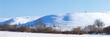 Panoramic view of snow-covered hills in central Russia. Winter s