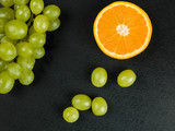 Bunch of Grapes With An Orange