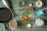 Cooking pancakes gluten free on the light blue table - 135450529