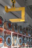 Crane hook unloading steel sheet coils - 135473159