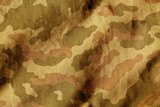 Fototapety Weathered camouflage cloth texture.