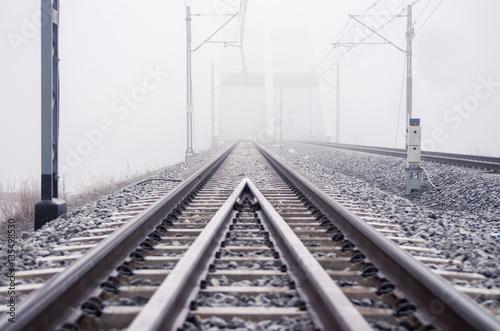 Railroad tracks, foggy winter morning.