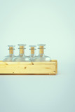 Old empty bottles in wooden box. 3D illustration