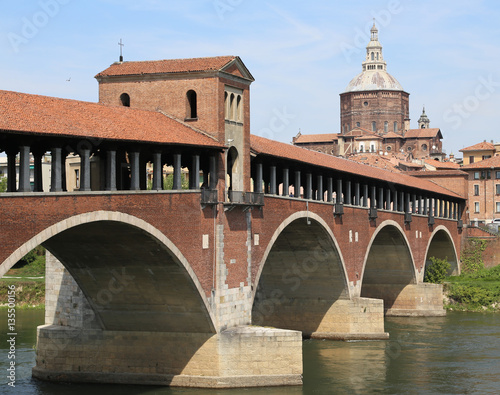 Poster covered bridge over the TICINO River in Pavia City in Italy
