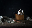 Still Life with a box of letters, and smoking a cigarette. dark background. vintage