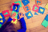little girl playing with puzzle, early education - 135537389
