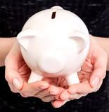 Piggy bank in woman hands