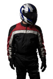 Man wearing a protective leather and textile racing suit for race cars and motorcycle motor sports.  The gear is armored with a helmet and worn by bikers and professional drivers.