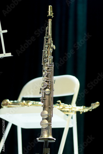 Poster Tenor saxophone on stage. Musical wind instrument. Saxophone