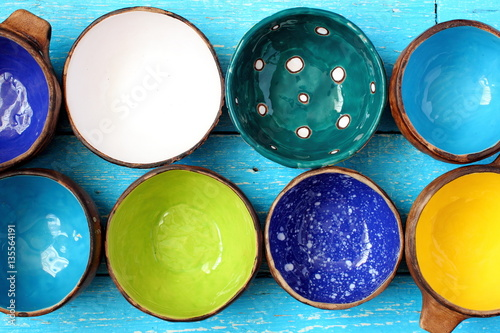 Fotobehang Pop Art Many different bright multicolored ceramic bowls and cups handcrafted. Top view. View from above. Background texture