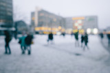 Crowd of people in city in winter, intentional out of focus blur for anonymity