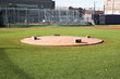 Pitchers mound covered with a tarp