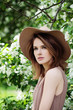 Beautiful Woman in a Hat Outdoors. Healthy Spring Portrait