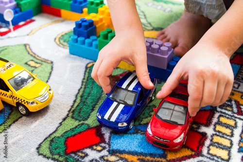 boy playing toy cars - 135599701