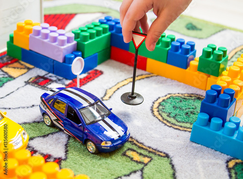 boy playing toy cars - 135600580