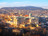 View of Buda Castle from Gellert Hill on sunny evening, Budapest, Hungary, Europe, UNESCO World Heritage Site.