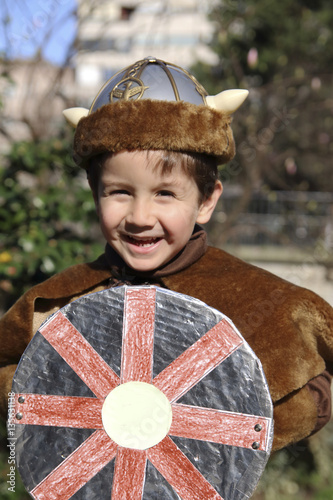 happy little kid with a Viking costume in carnival Poster