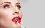 Beauty Shot and Makeup Concept.  Red Lipgloss