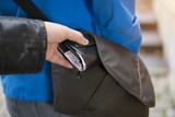 Pickpocket stealing a wallet - 135634564