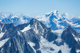 Ice, snow, and glaciers cling to the sides of Mont Blanc in the french Alps